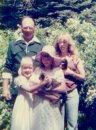 Me and my sisters with Dad (not a recent pic)