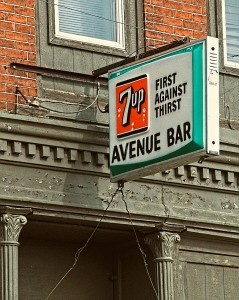 A vintage 7 Up tavern sign on a bar in Columbus, Nebraska.