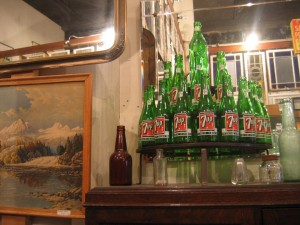 Vintage 7 Up bottles on display in a Seattle, Washington antique store.